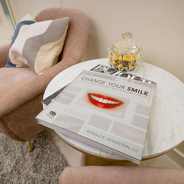 A magazine cover showing a smile in the office waiting area