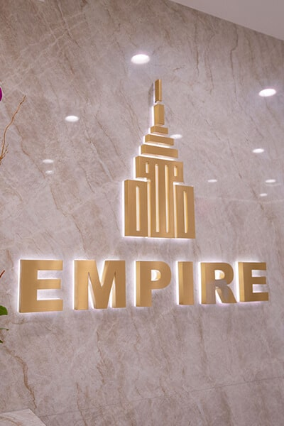 Empire Dental Aesthetics logo on dental office wall
