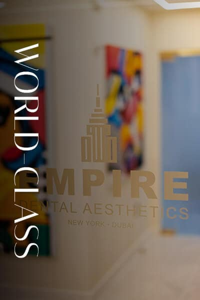 Empire Dental Aesthetics Logo on a glass door
