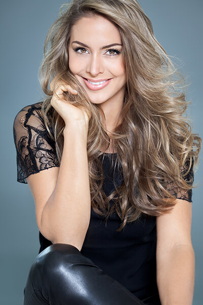 Attractive woman wearing black sitting with a beautiful smile
